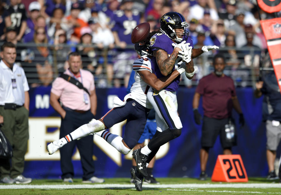 <p>Baltimore Ravens wide receiver Chris Moore, right, is unable to catch a pass attempt as he is tackled by Chicago Bears cornerback Kyle Fuller in the second half of an NFL football game, Sunday, Oct. 15, 2017, in Baltimore. (AP Photo/Nick Wass) </p>