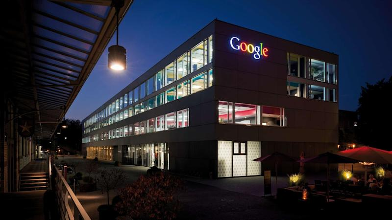 Building lit up with the Google logo at night