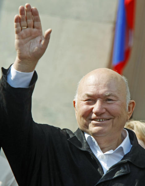 FILE - In this Saturday May 1, 2010 file photo, Moscow Mayor Yuri Luzhkov waves as United Russia party and government-linked trade unions take to the streets to mark May Day in Moscow. The former mayor of Moscow and one of the founders of Russia's ruling United Russia party, Yuri Luzhkov, has died at the age of 83. Russia's Ren TV channel reported Tuesday Dec. 10, 2019, that Luzhkov died in Munich, where he was undergoing heart surgery. (AP Photo/Mikhail Metzel)