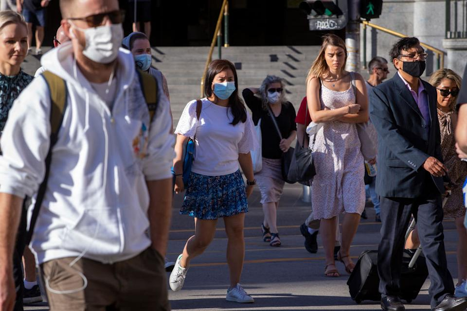 People walking with face masks on during the coronavirus pandemic.