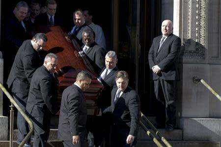 Actor Phillip Seymour Hoffman's casket is carried out following the funeral in the Manhattan borough of New York