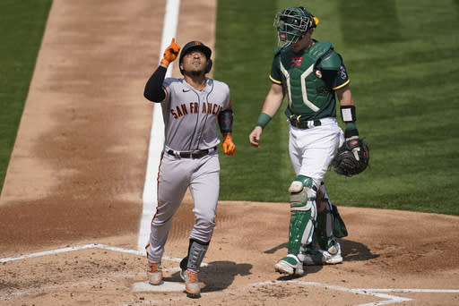 After a pair of shutouts, Giants respond to rout A's 14-2