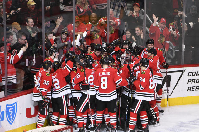 The Chicago Blackhawks celebrate Chicago Blackhawks right wing Patrick Kane (88) 1,000th point on an assist against the Winnipeg Jets during the third period of an NHL hockey game Sunday, Jan. 19, 2020, in Chicago. (AP Photo/David Banks)