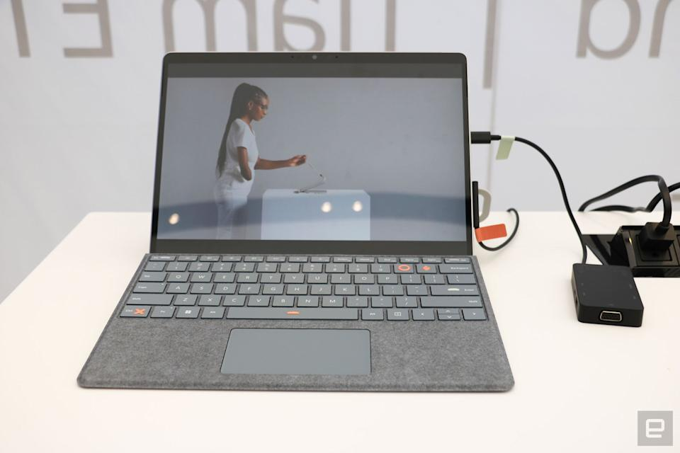 <p>A Surface Pro with labels and stickers from the Adaptive Kit attached to its charging cables and space bar, left control key and the P and O buttons.</p>