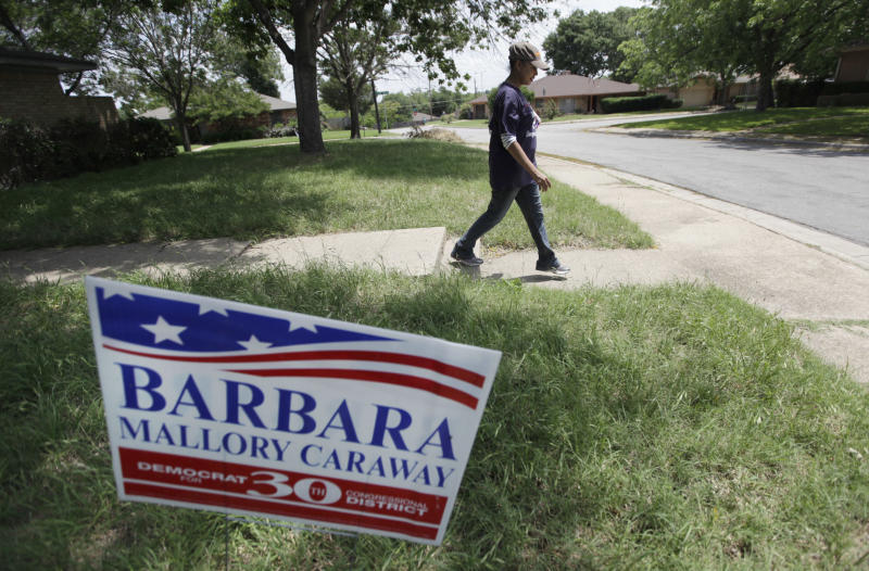 In this photo taken May 1, 2012, Texas State Rep. Barbara Mallory Caraway, D-Dallas walks a neighborhood while posting flyers for her campaign to win the 30th Congressional District race. For two decades, Eddie Bernice Johnson has been an outspoken voice for Democrats in a bright blazer and multicolored scarf. But for the first time, the first black woman to represent North Texas in Congress is facing serious opposition in this month's primary. And the effort to unseat her is just one of several challenges being mounted against some of the longest-serving blacks in Congress. (AP Photo/LM Otero)
