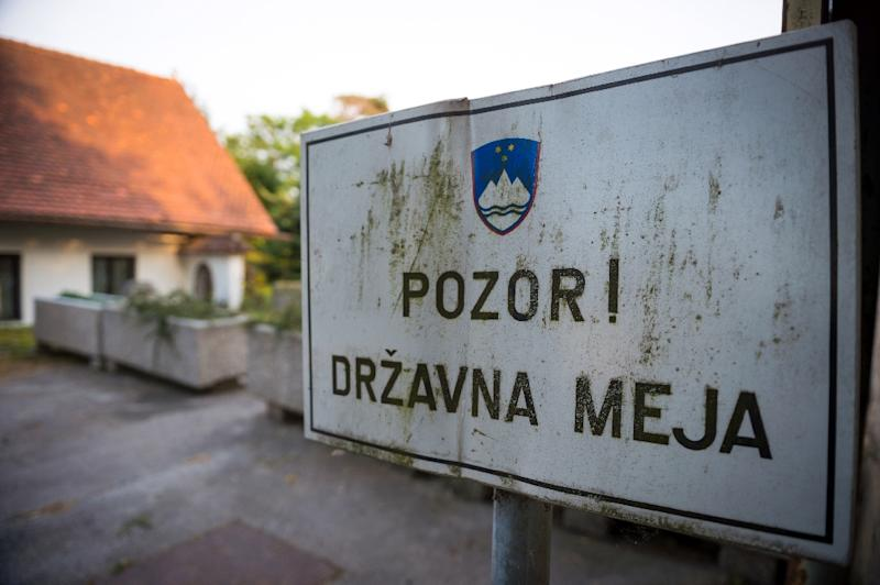 "A sign reading ""Attention! National Border'', indicating the Slovenian-Croatian border in Obrezje, Slovenia on June 18, 2013"