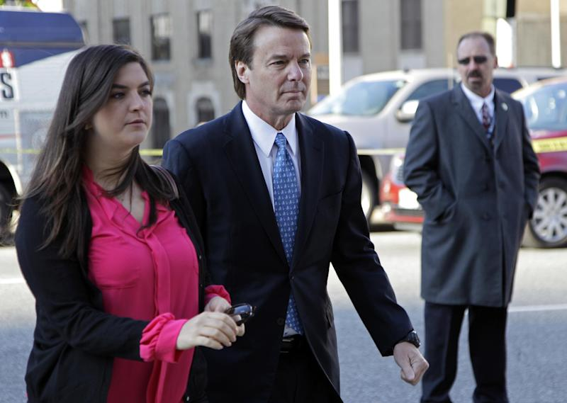Former presidential candidate and U.S. Sen. John Edwards, center, arrives outside federal court with his daughter Cate, left, in Greensboro, N.C., for his trial on charges of violating federal campaign finance laws, Monday, April 23, 2012. Opening statements were to begin Monday. Edwards, 58, pleaded not guilty to six criminal counts related to nearly $1 million in secret payments from two wealthy supporters. Much of the money was used to hide the then-married politician's pregnant mistress during his 2008 White House campaign. (AP Photo/Chuck Burton)