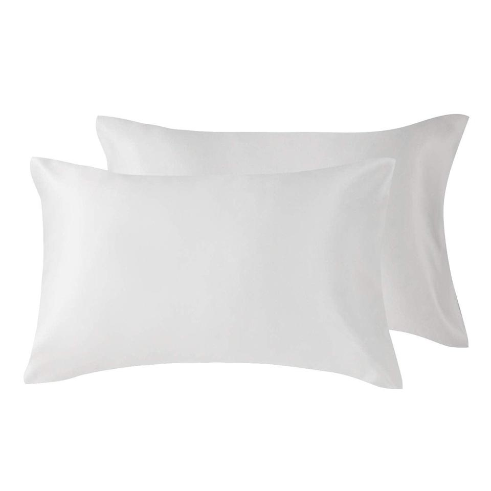 """<h3>Silk Satin Pillowcase Set</h3><br>This 38%-off set of satin-silk pillowcases rose to most wanted fame after being spotlighted as a reader's <a href=""""https://www.refinery29.com/en-us/best-things-on-amazon-hidden-gems#slide-3"""" rel=""""nofollow noopener"""" target=""""_blank"""" data-ylk=""""slk:Amazon Hidden Gem"""" class=""""link rapid-noclick-resp"""">Amazon Hidden Gem</a> that she swears by for protecting her hair and skin while catching ZZZs. """"They are so smooth and buttery and make me feel like I'm sleeping at a 5-star hotel. I've also noticed a huge difference in my hair, it's way less frizzy when I wake up in the morning and my style is still intact from the day before,"""" she raved.<br><br><strong>4.5 out of 5 stars and 13,979 reviews</strong><br><br><strong>Love's Cabin</strong> Silk Satin Pillowcase, Set of 2, $, available at <a href=""""https://amzn.to/34T9iFA"""" rel=""""nofollow noopener"""" target=""""_blank"""" data-ylk=""""slk:Amazon"""" class=""""link rapid-noclick-resp"""">Amazon</a>"""