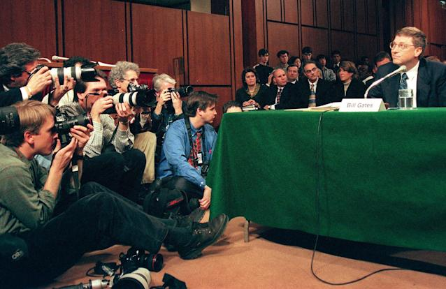 Photographers focus on Microsoft Chairman Bill Gates as he testifies during hearings before the US Senate Judiciary Committee on Capitol Hill in Washington, DC. March 3, 1998. (JESSICA PERSSON/AFP/Getty Images)