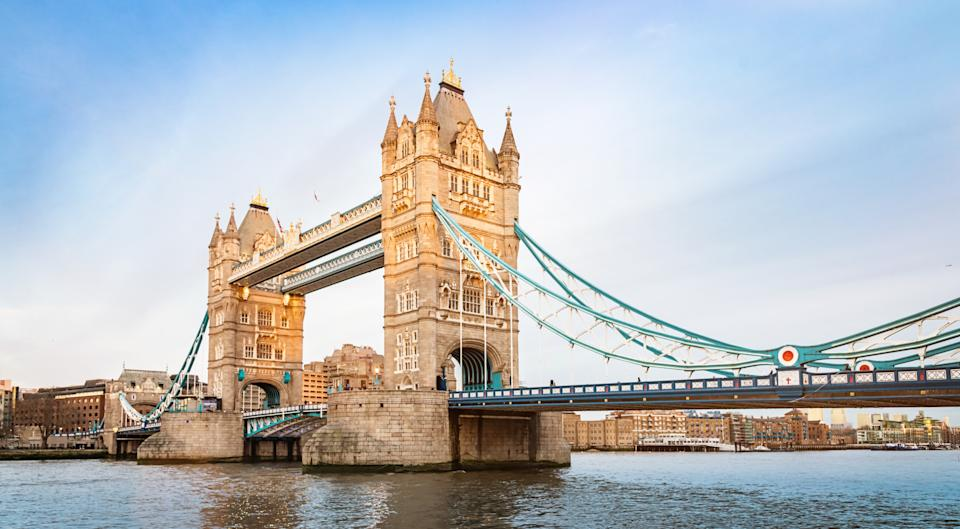 Panorama of famous Tower Bridge in the sunlight and River Thames in London at day. London, United Kingdom.