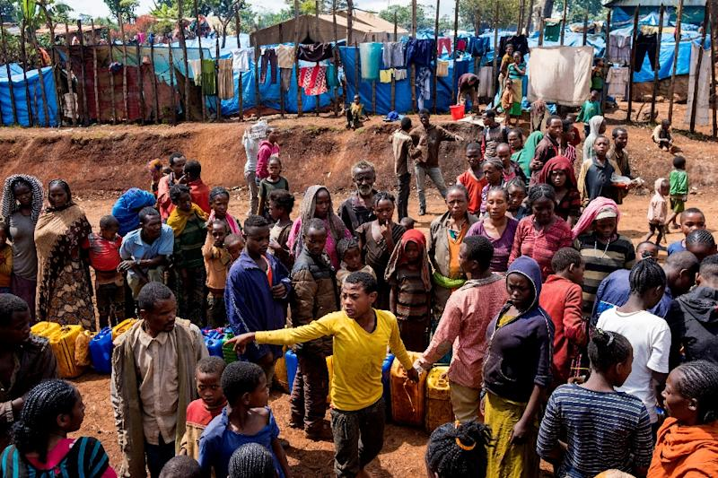 Displaced Gedeo people wait in line for a water at a camp, after fleeing their homes (AFP Photo/Maheder HAILESELASSIE TADESE)