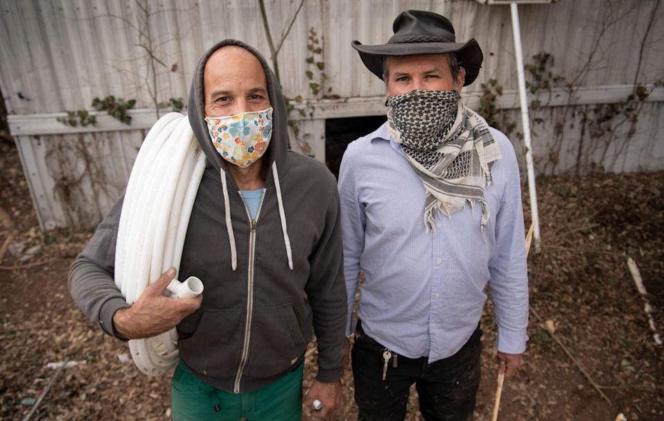 Michael Kunitzky and Colby Adams of the Austin Guerrilla Plumber Corps pose for a portrait Thursday, Feb. 25, 2021 in Austin, Texas. The corps of five friends, is working to repair underprivileged residents' plumbing problems caused by the winter storm.