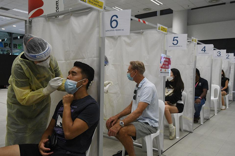 SINGAPORE, Feb. 27, 2021 -- Medical workers take swab samples from spectators for COVID-19 test before the Singapore Tennis Open semifinal in Singapore, Feb. 27, 2021. (Photo by Then Chih Wey/Xinhua via Getty) (Xinhua/Then Chih Wey via Getty Images)