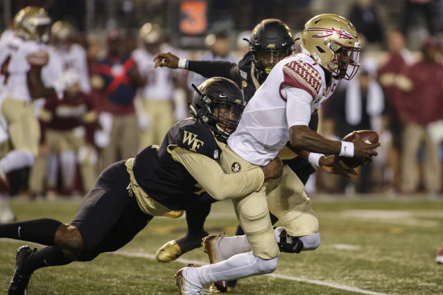 Wake Forest linebacker JaCorey Johns, left, sacks Florida State quarterback James Blackman in the first half of an NCAA college football game in Winston-Salem, N.C., Saturday, Oct. 19, 2019. (AP Photo/Nell Redmond)