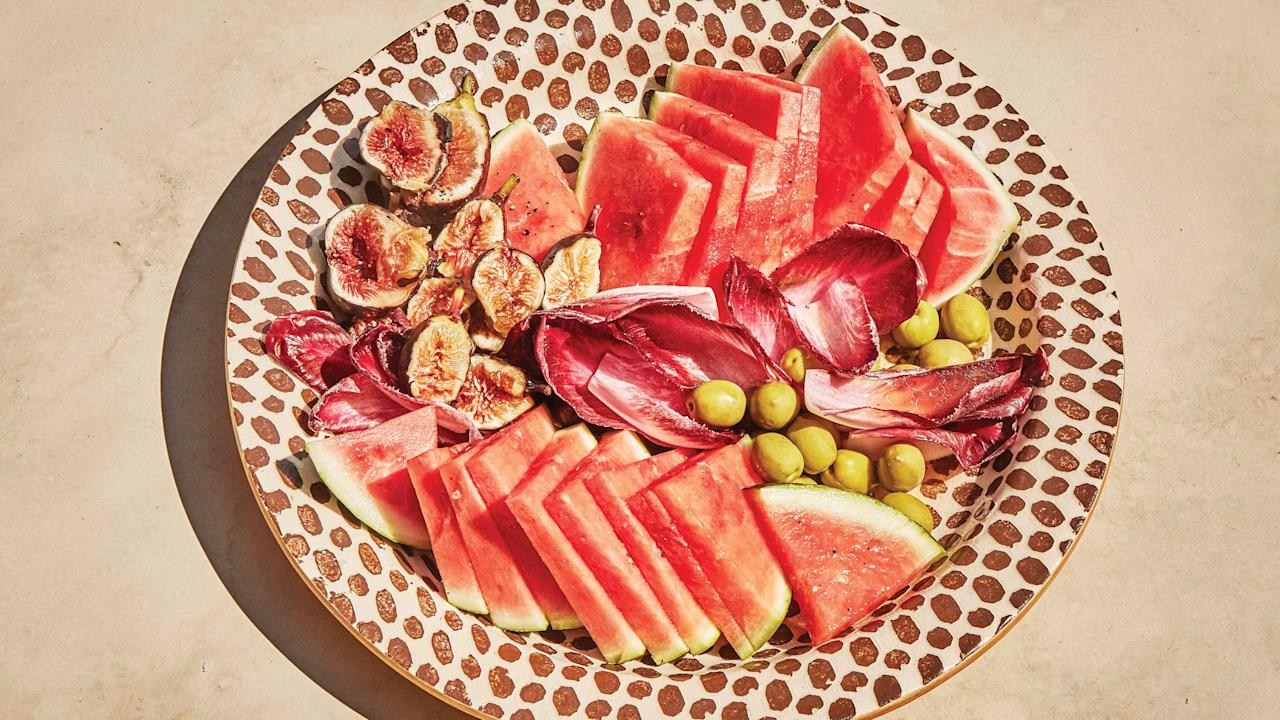 """Less of a recipe and more of a serving suggestion, this combination of sweet and salty flavors and crunchy and juicy textures is the perfect side salad or a cocktail hour snack platter. The contrasting ingredients are united by a super simple lemon vinaigrette and, of course, a sprinkle of flaky salt. <a href=""""https://www.bonappetit.com/recipe/watermelon-endive-and-fig-salad?mbid=synd_yahoo_rss"""">See recipe.</a>"""