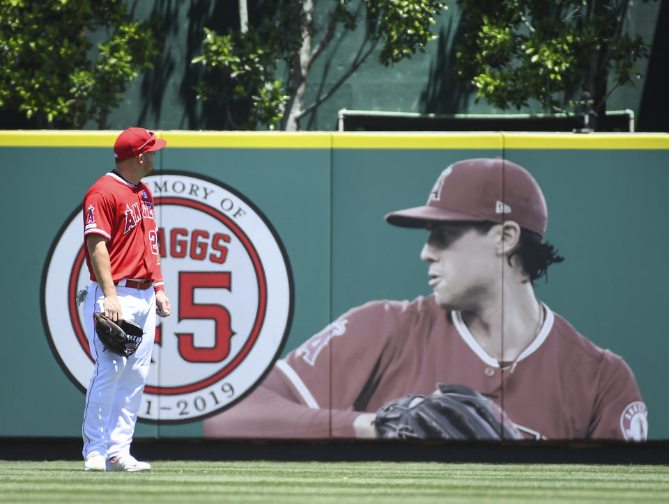 ANAHEIM, CA - JULY 28: Los Angeles Angels Center field Mike Trout (27) looks toward the Tyler Skaggs Memorial during a game against the Oriole on July 28, 2019, at Angel Stadium of Anaheim in Anaheim, CA.   (Photo by Carrie Giordano (Jesenovec)/Icon Sportswire via Getty Images)