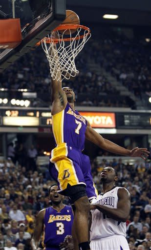 Los Angeles Lakers guard Ramon Sessions (7) goes to the basket past Sacramento Kings guard Tyreke Evans, right, during the first half of an NBA basketball game in Sacramento, Calif., Thursday, April 26, 2012. (AP Photo/Rich Pedroncelli)