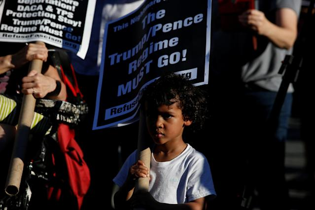 <p>A young protester participates as people protest against the Trump administration's policy of separating immigrant families suspected of illegal entry, in New York, N.Y. on June 19, 2018. (Photo: Brendan McDermid/Reuters) </p>
