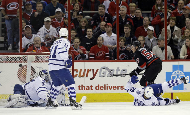 Carolina Hurricanes' Jeff Skinner (53) scores on Toronto Maple Leafs goalie James Reimer as Maple Leafs' Jay McClement (11) and Jerry D'Amigo (29) defend during the first period of an NHL hockey game in Raleigh, N.C., Thursday, Jan. 9, 2014. (AP Photo/Gerry Broome)