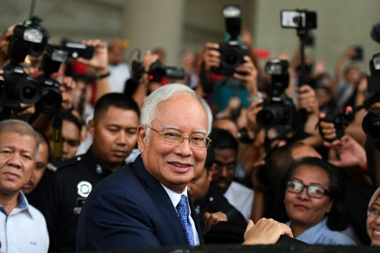 Huge sums were looted from Malaysian sovereign wealth fund 1MDB in a globe-spanning fraud, which allegedly involved ex-leader Najib Razak and his inner circle (AFP Photo/Mohd RASFAN)