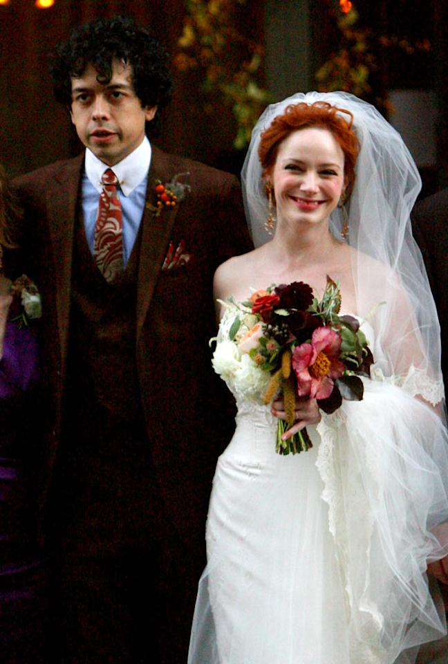 "Christina Hendricks has walked plenty of red carpets too, but last Sunday she walked down the aisle. The sexy secretary from ""Mad Men"" wed actor Geoffrey Arend. <a href=""http://www.infdaily.com"" target=""new"">INFDaily.com</a> - October 11, 2009"