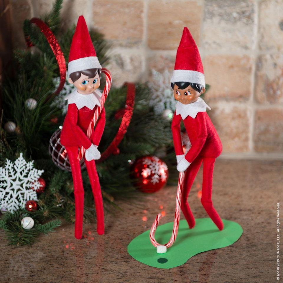 """<p>Green felt makes for the loveliest putting green, don't you think? And candy canes are <em>excellent</em> clubs.</p><p><strong>Get the tutorial at <a href=""""https://elfontheshelf.com/elf-ideas/north-pole-putt-putt/"""" rel=""""nofollow noopener"""" target=""""_blank"""" data-ylk=""""slk:Elf on the Shelf"""" class=""""link rapid-noclick-resp"""">Elf on the Shelf</a>.</strong></p><p><a class=""""link rapid-noclick-resp"""" href=""""https://go.redirectingat.com?id=74968X1596630&url=https%3A%2F%2Fwww.walmart.com%2Fsearch%2F%3Fquery%3Dcandy%2Bcanes&sref=https%3A%2F%2Fwww.thepioneerwoman.com%2Fholidays-celebrations%2Fg34080491%2Ffunny-elf-on-the-shelf-ideas%2F"""" rel=""""nofollow noopener"""" target=""""_blank"""" data-ylk=""""slk:SHOP CANDY CANES"""">SHOP CANDY CANES</a></p>"""