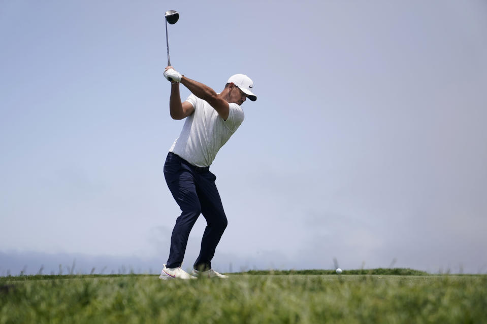 Brooks Koepka hits from the fourth tee during the first round of the U.S. Open Golf Championship, Thursday, June 17, 2021, at Torrey Pines Golf Course in San Diego. (AP Photo/Jae C. Hong)