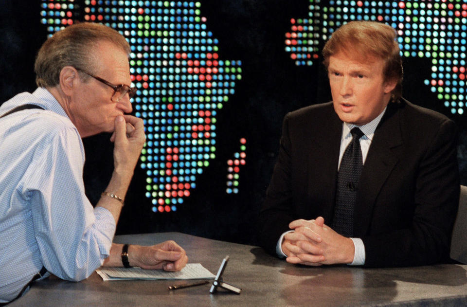 "FILE - In this Oct. 7, 1999 file photo, Donald Trump, right, is interviewed by Larry King during a taping of ""Larry King Live,"" in New York. King, who interviewed presidents, movie stars and ordinary Joes during a half-century in broadcasting, has died at age 87. Ora Media, the studio and network he co-founded, tweeted that King died Saturday, Jan. 23, 2021 morning at Cedars-Sinai Medical Center in Los Angeles. (AP Photo/Marty Lederhandler, File)"