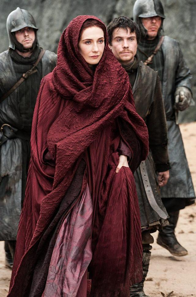 Melisandre with Gendry in Season 3 of <em>Game of Thrones</em>(Photo: HBO)