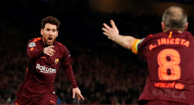 Soccer Football - Champions League Round of 16 First Leg - Chelsea vs FC Barcelona - Stamford Bridge, London, Britain - February 20, 2018 Barcelona's Lionel Messi celebrates scoring their first goal with Andres Iniesta Action Images via Reuters/Andrew Boyers