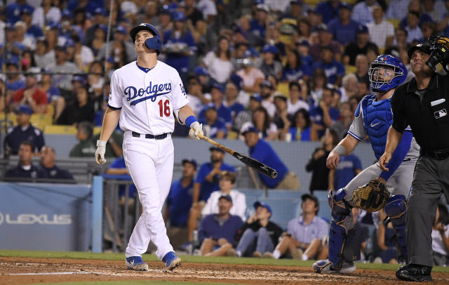 Los Angeles Dodgers' Will Smith, left, watches his solo home run, next to Toronto Blue Jays catcher Reese McGuire, center, and home plate umpire Brian Knight during the fourth inning of a baseball game Wednesday, Aug. 21, 2019, in Los Angeles. (AP Photo/Mark J. Terrill)