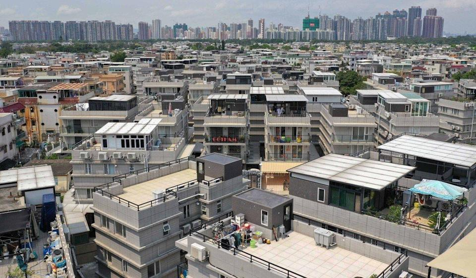 Houses built by villages in Yuen Long. The current policy limits such structures to only three storeys. Photo: Winson Wong