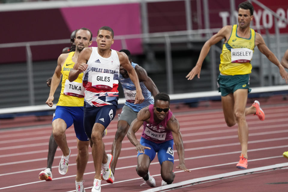Isaiah Jewett, of United the States, and Nijel Amos, of Botswana, fall in the men's 800-meter semifinal at the 2020 Summer Olympics, Sunday, Aug. 1, 2021, in Tokyo.(AP Photo/Jae C. Hong)