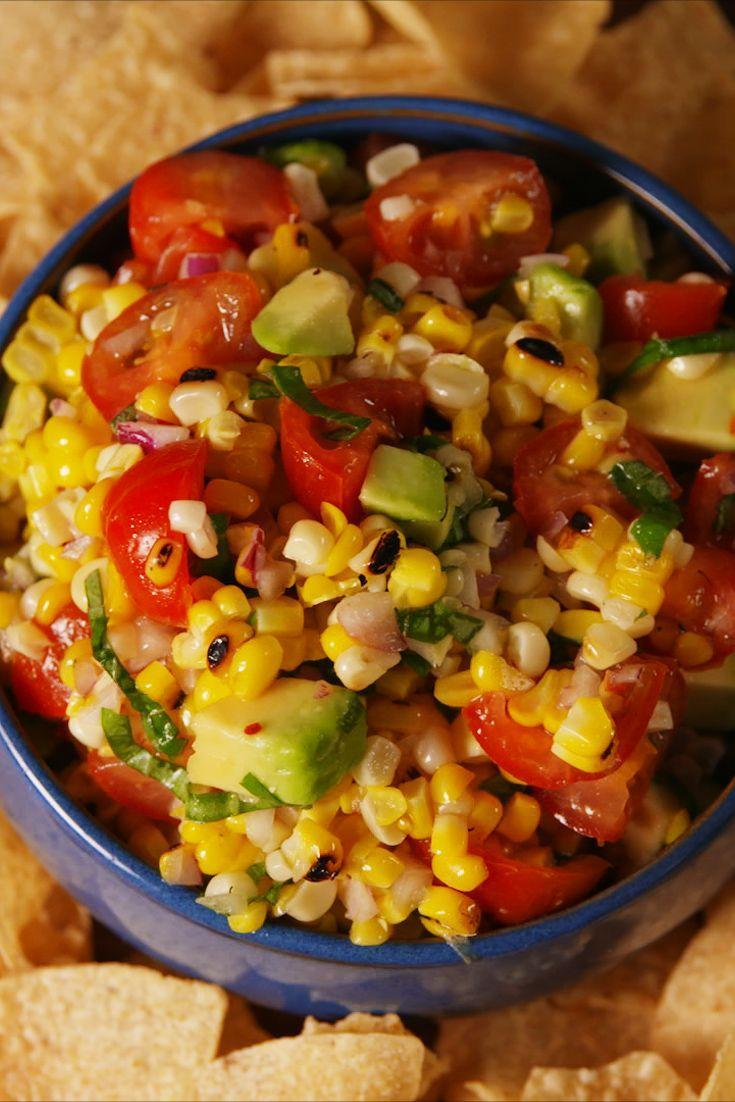 """<p>With tangy lime and sweet basil, this grilled corn salsa couldn't be more perfect for summer.</p><p>Get the recipe from <a href=""""https://www.delish.com/cooking/recipe-ideas/recipes/a53802/best-corn-salsa-recipe/"""" rel=""""nofollow noopener"""" target=""""_blank"""" data-ylk=""""slk:Delish"""" class=""""link rapid-noclick-resp"""">Delish</a>.</p>"""