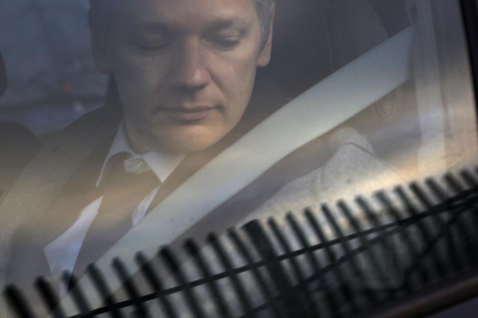 <p> FILE - In this Jan. 11, 2011 file photo, WikiLeaks founder Julian Assange arrives at Belmarsh Magistrate's court in London for an extradition hearing. According to a cache of internal WikiLeaks files obtained by The Associated Press, Assange sought a Russian visa and staffers at his radical transparency group discussed having him skip bail and escape Britain as authorities closed in on him in late 2010. (AP Photo/Sang Tan) </p>