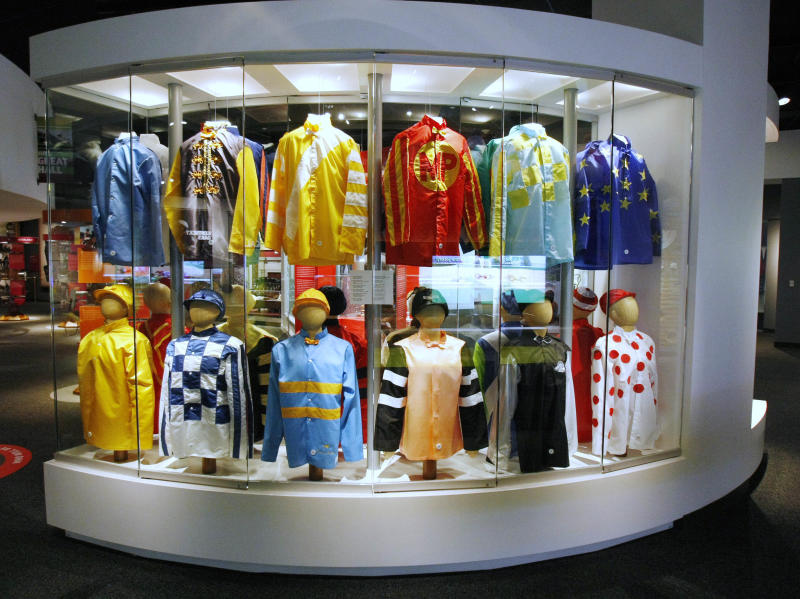 FILE - This Monday, April 19, 2010 file photo shows a display of Kentucky Derby winners' silks at the Kentucky Derby Museum in Louisville, Ky. Although Louisville is best-known for the Derby, visitors in town for the May 5, 2012 race will find plenty of other things to do and see around town, from museums to historic hotels to trendy restaurants. (AP Photo/Ed Reinke)