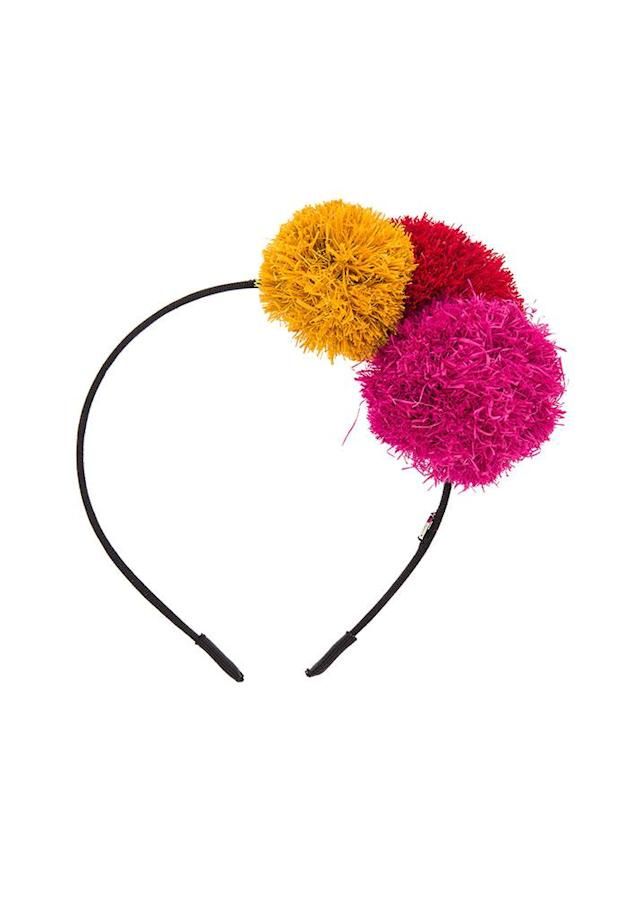 "You can never have enough pom-poms. $58; at <a href=""http://www.revolve.com/eugenia-kim-lorelei-headband/dp/EUGE-WA111/?d=Womens&page=2&lc=72&itrownum=24&itcurrpage=2&itview=01"" rel=""nofollow noopener"" target=""_blank"" data-ylk=""slk:Revolve"" class=""link rapid-noclick-resp"">Revolve</a>"