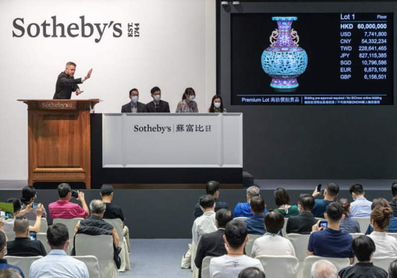 Photo shows Sotheby's auction of rare Chinese vase which sold for A$13 million.