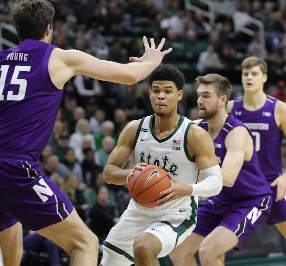 Michigan State guard Malik Hall passes against Northwestern center Ryan Young during the first half of MSU's 79-50 win on Wednesday, Jan. 29, 2020, at the Breslin Center.
