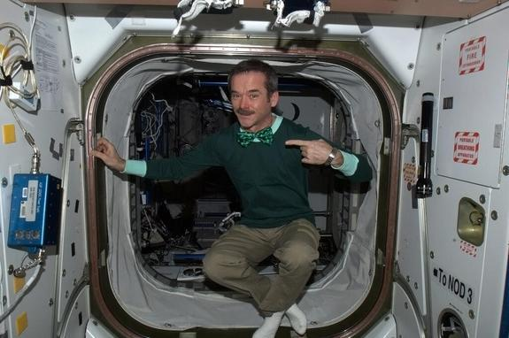 Canadian astronaut Chris Hadfield floats inside the International Space Station clad all in green for St. Patrick's Day on March 17, 2013.