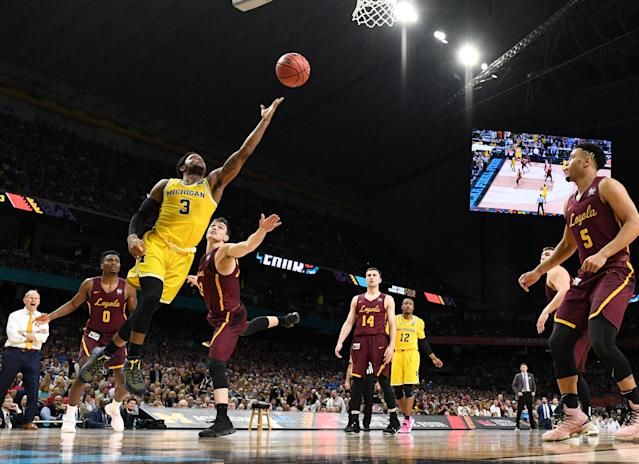 Mar 31, 2018; San Antonio, TX, USA; Michigan Wolverines guard Zavier Simpson (3) lays the ball up past Loyola Ramblers guard Clayton Custer (13) during the second half in the semifinals of the 2018 men's Final Four at Alamodome. Mandatory Credit: Robert Deutsch-USA TODAY Sports TPX IMAGES OF THE DAY