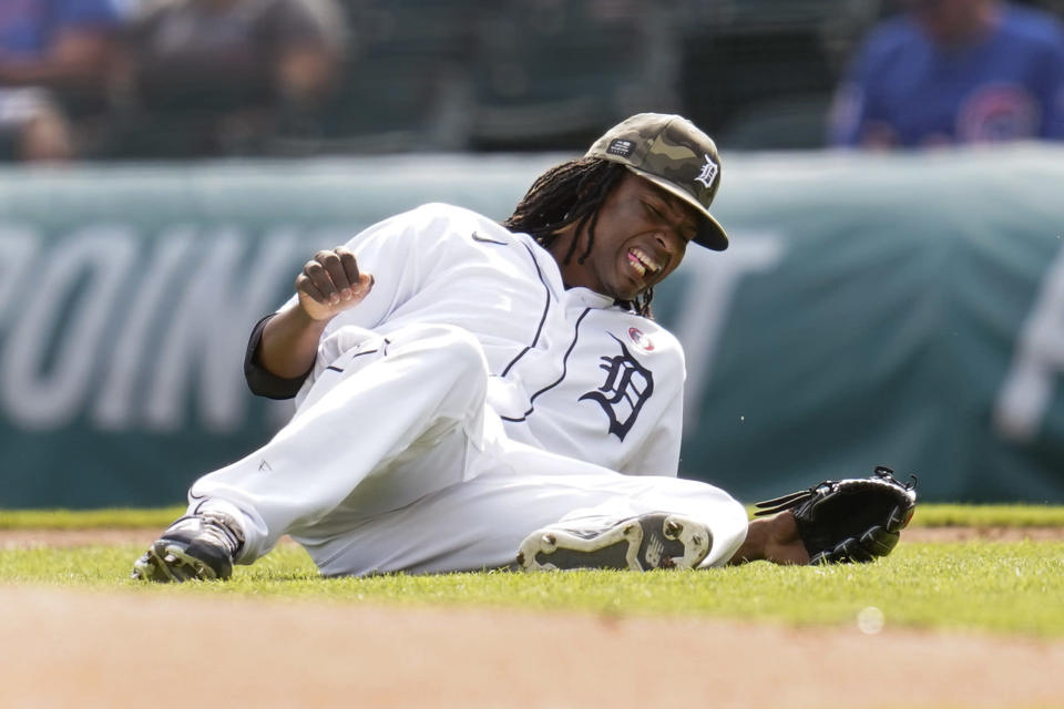 Detroit Tigers' pitcher Jose Urena grimaces after being hit by a Chicago Cubs' Jason Heyward line drive in the second inning of a baseball game in Detroit, Saturday, May 15, 2021. (AP Photo/Paul Sancya)