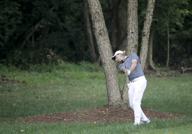 Rory McIlroy of Northern Ireland, hits from the rough on the 12th hole during the second round of the PGA Championship golf tournament at the Quail Hollow Club Friday, Aug. 11, 2017, in Charlotte, N.C. (AP Photo/John Bazemore)