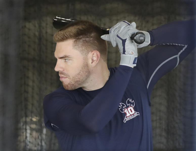 Atlanta Braves' Freddie Freeman takes his first swings of baseball spring training after arriving for camp Sunday, Feb. 16, 2020, in North Port, Fla. (Curtis Compton /Atlanta Journal-Constitution via AP)