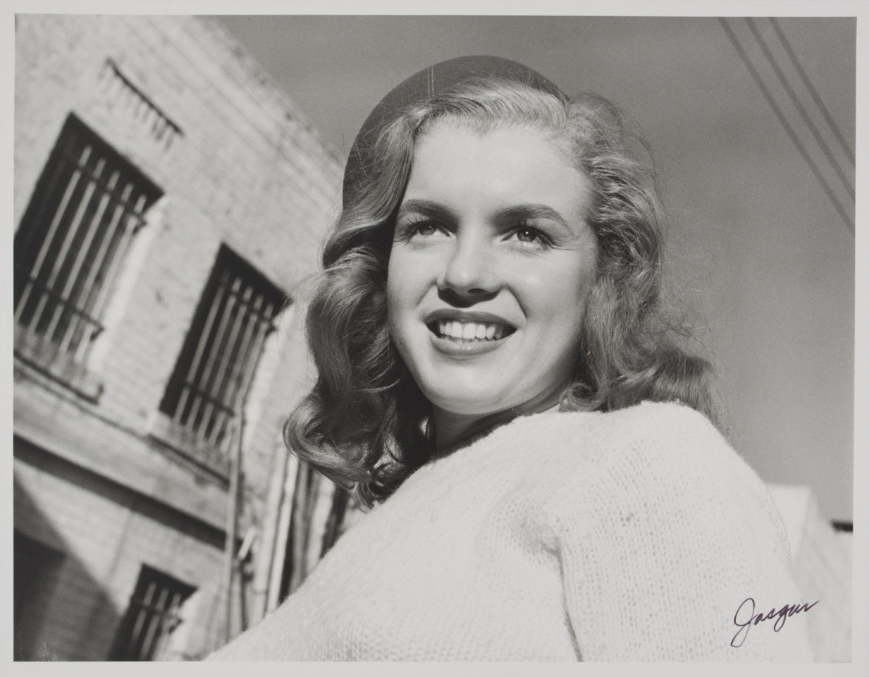 In this 1946 image taken by photographer Joseph Jasgur and released by Julien's Auctions, a photo of Norma Jean Dougherty, who eventually changed her name to Marilyn Monroe, is shown. A bankruptcy judge in Florida ruled earlier this week that photos taken of Monroe will be sold at auction to settle the debts of the photographer. Jasgur's photos, negatives and image copyrights will be sold in December by Julien's Auctions. (AP Photo/Julien's Auctions, Joseph Jasgur)