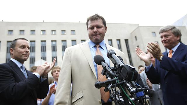 Former Major League Baseball pitcher Roger Clemens, center, is applauded by his attorney's, Rusty Hardin, right, and Michael Attanasio, left, outside federal court in Washington, Monday, June 18, 2012. Clemens was acquitted on all charges by a jury that decided that he didn't lie to Congress when he denied using performance -enhancing drugs. (AP Photo/Pablo Martinez Monsivais)