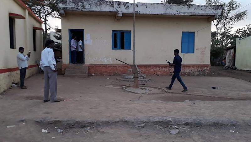 Five men were dragged to the village council office and battered to death with sticks and blunt objects