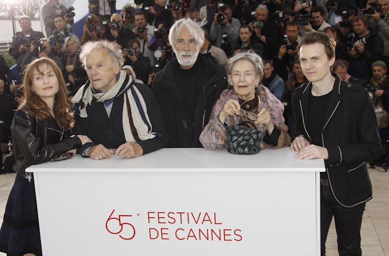 Cast members from left, Isabelle Huppert , Jean-Louis Trintignant, Director Michael Haneke, Emmanuelle Riva and Alexandre Tharaud pose during a photo call for Love at the 65th international film festival, in Cannes, southern France, Sunday, May 20, 2012. (AP Photo/Joel Ryan)