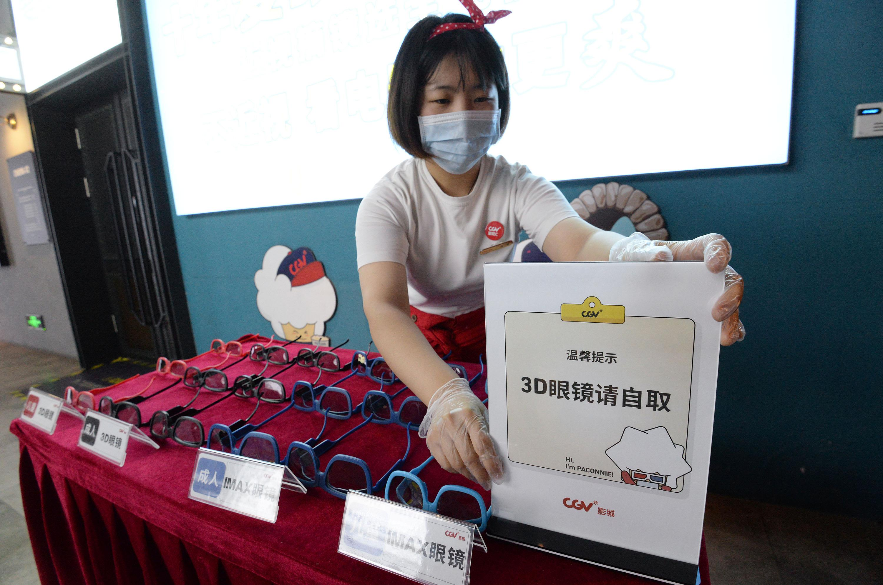 HANDAN, CHINA - JULY 19, 2020 - Staff of a cinema display warm warning signs in Handan, Hebei Province, China, July 19, 2020.- PHOTOGRAPH BY Costfoto / Barcroft Studios / Future Publishing (Photo credit should read Costfoto/Barcroft Media via Getty Images)