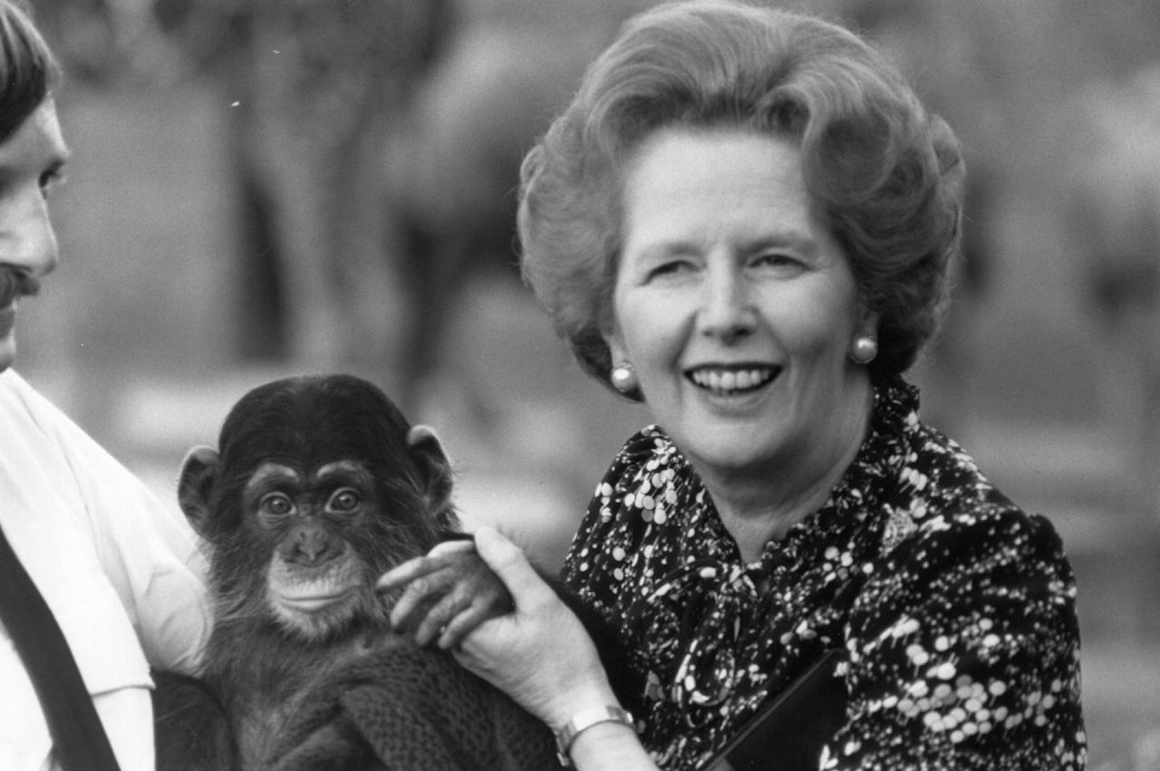 1985:  British Conservative prime minister Margaret Thatcher, right, poses with a chimp and its keeper.  (Photo by Hulton Archive/Getty Images)